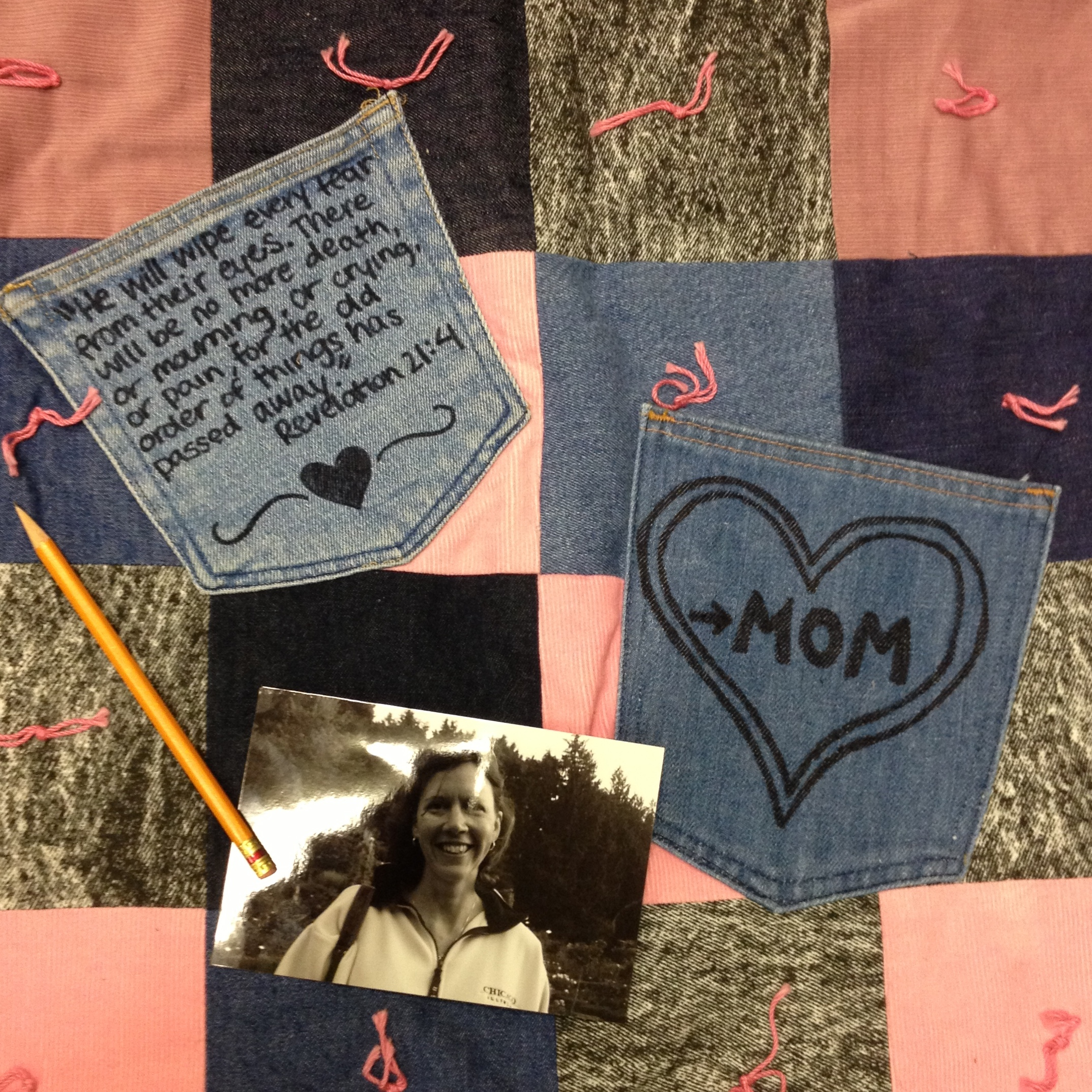 mom quilt with revelation verse